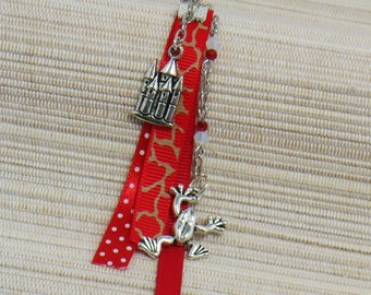 Red and silver metal with his frog and his Castle bookmarks