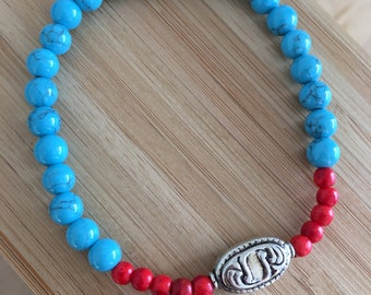 Turquoise dyed howlite bracelet with ornate silver bead