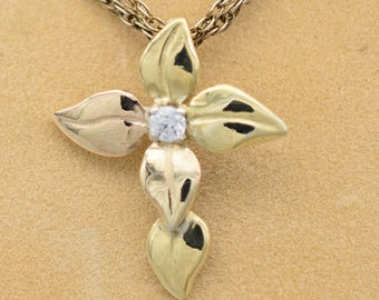 18k gold cross made of leaves with center .05 ct vs1 diamond; completely hand-fabricated pendant