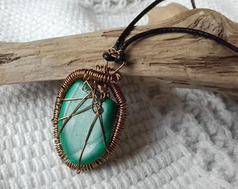 Malachite, rich dark green semi precious stone,copper wire wrapped & hung on leather cord.