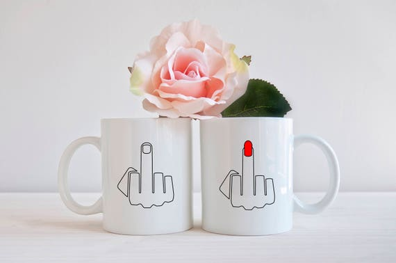 Matching middle finger couples coffee mugs