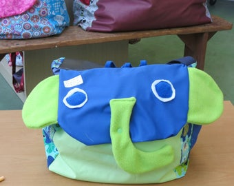 bag chest has toy elefant and slate Green Board and hand made blue