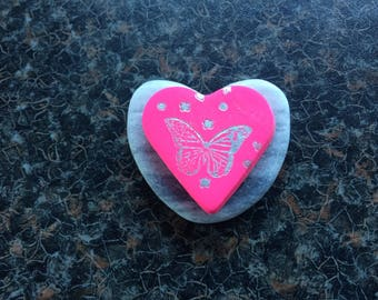 Candy Pink clay heart embossed with silver butterfly mounted on heart shaped stone