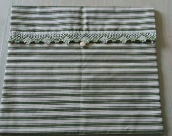 Pouch has green and white stripes and lace