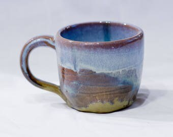 Wheel-thrown mug with opal and olive green glaze