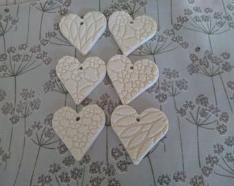 Six Porcelain decorative hearts - free postage