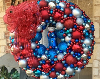 """Beautiful large 17"""" Red, turquoise and light blue, and silver wreath with a cute Mr Snowman ornament and res bow"""