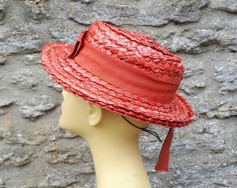 Vintage orange straw boater hat