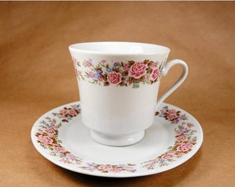 ON SALE Vintage white porcelain teacup and saucer with roses and flowers