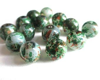 10 painted white speckled green and orange glass beads 8mm