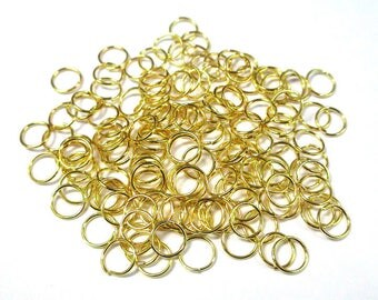 100 7mm color gold plated jump rings
