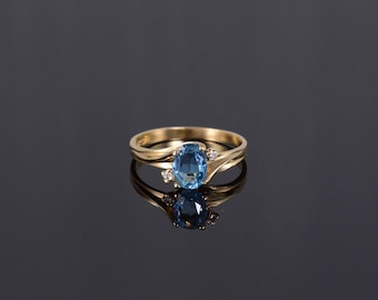 14k 1.04 Ctw Blue Topaz Diamond Oval Bypass Ring Gold