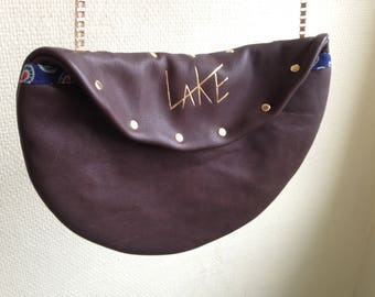 Brown clutch shoulderbag