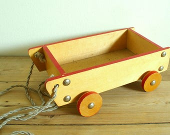 Vintage wooden pull toy wagon.Wooden toy cart wood red.Cart on wheels.Home decor.Nursery decor.Vintage wood toy photo prop.Display decor