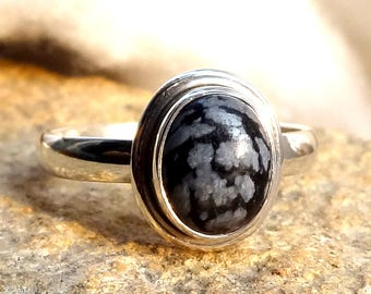 A beautiful snowflake obsidian stone sterling silver 925.