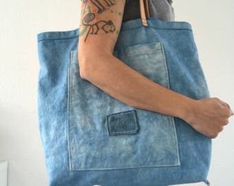 Indigo dyed simple canvas tote bag with leather handles