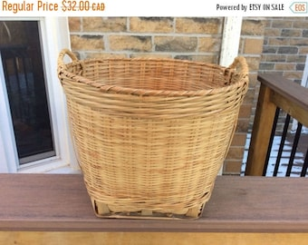On Sale Vintage handwoven basket with handles. Wicker catch all  basket with handles. Vegetable basket. Shoe basket. Storage basket. Garbage