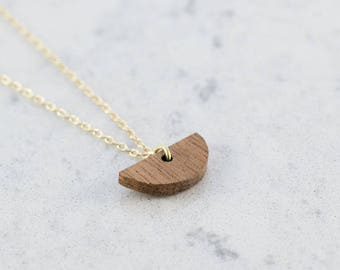 Half moon shaped necklace made of sapelle wood,