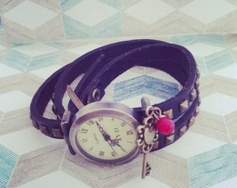 shows triple bracelet with metal key