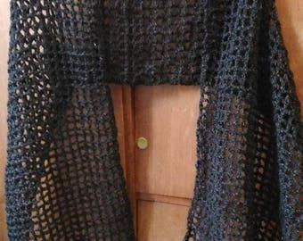 Black shawl with openwork crochet stitches