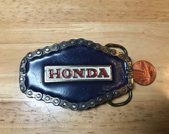 Great American Buckle Chicago 1976 Honda. Good condition. Serial number 608. Size~80x50