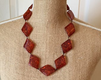 Amber coloured confetti lucite type necklace