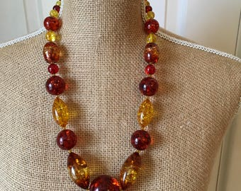 Faux amber coloured confetti lucite type necklace