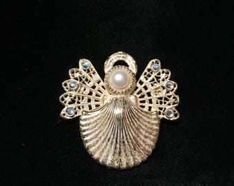 Kenneth Cole Gold tone angel pin.