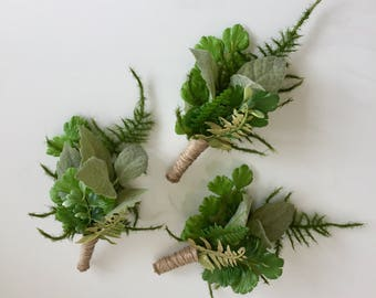 A woodland, botanical, foliage buttonhole
