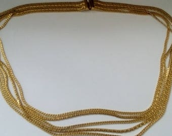 five strand gold coloured necklace