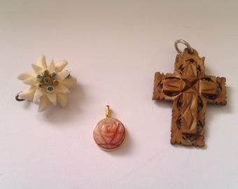 2 carved pendants and 1 carved brooch