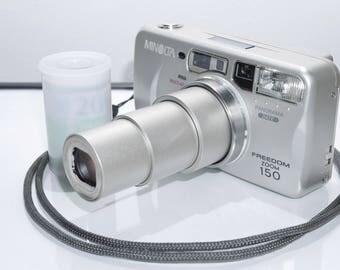 Minolta Freedom Zoom 150 Quartz Date 35mm 4X Zoom Camera and Film