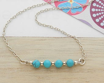 Necklace in silver and turquoise balls