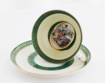 Small partially handpainted portrait-demitasse: dark-green/cream ft.a cameo with lovely Ladies, partly hand-decorated, goldcolor, c1930s