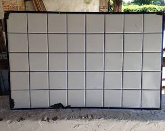 French metal tiled splasback