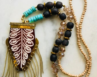 Horn with tassel necklace