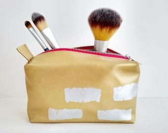 Gold foiled makeup bag with hot pink zip