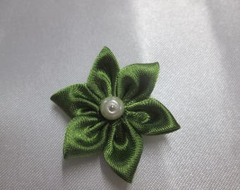 Green satin with a flower is adorned with an ivory Pearl Center