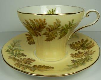 Aynsley Yellow Fall Leaves Gilt Corset Teacup and Saucer set Bone China