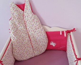 Bumper and baby pink sleeping bag, butterflies and polka dots.