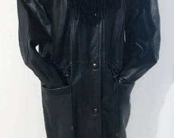 Vintage Women's Black Long Coat, Soft Genuine Leather Coat With Four Pockets and closes with Snap buttons by Laura Winston Size Medium