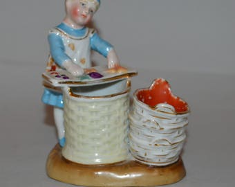 Victorian China Figure of a Child as a Match Holder or Striker