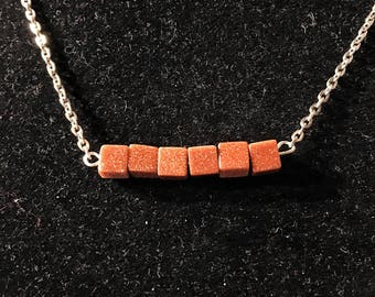 Goldstone pendant necklace