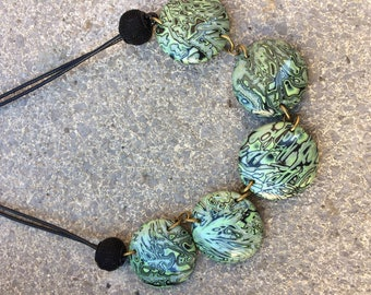 Green and black polymer necklace