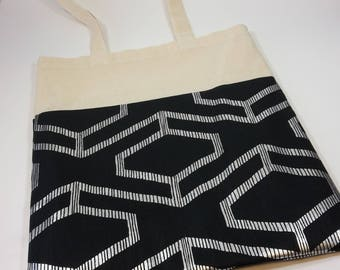 Black and silver fabric tote bag