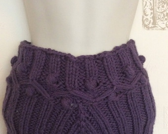 Special pattern with knobs adorns this hand knitted woolen teen's shorts