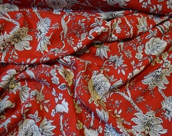 100% Viscose Fabric in Red with a White/Black Monochrome Floral Pattern - By the half metre