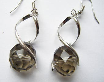 Earrings in silver metal and glass faceted bead