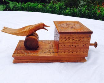 Cigarette dispenser hand carved wooden bird