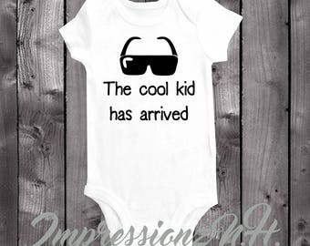 The cool kid has arrived - funny baby onesie, humerous baby bodysuit